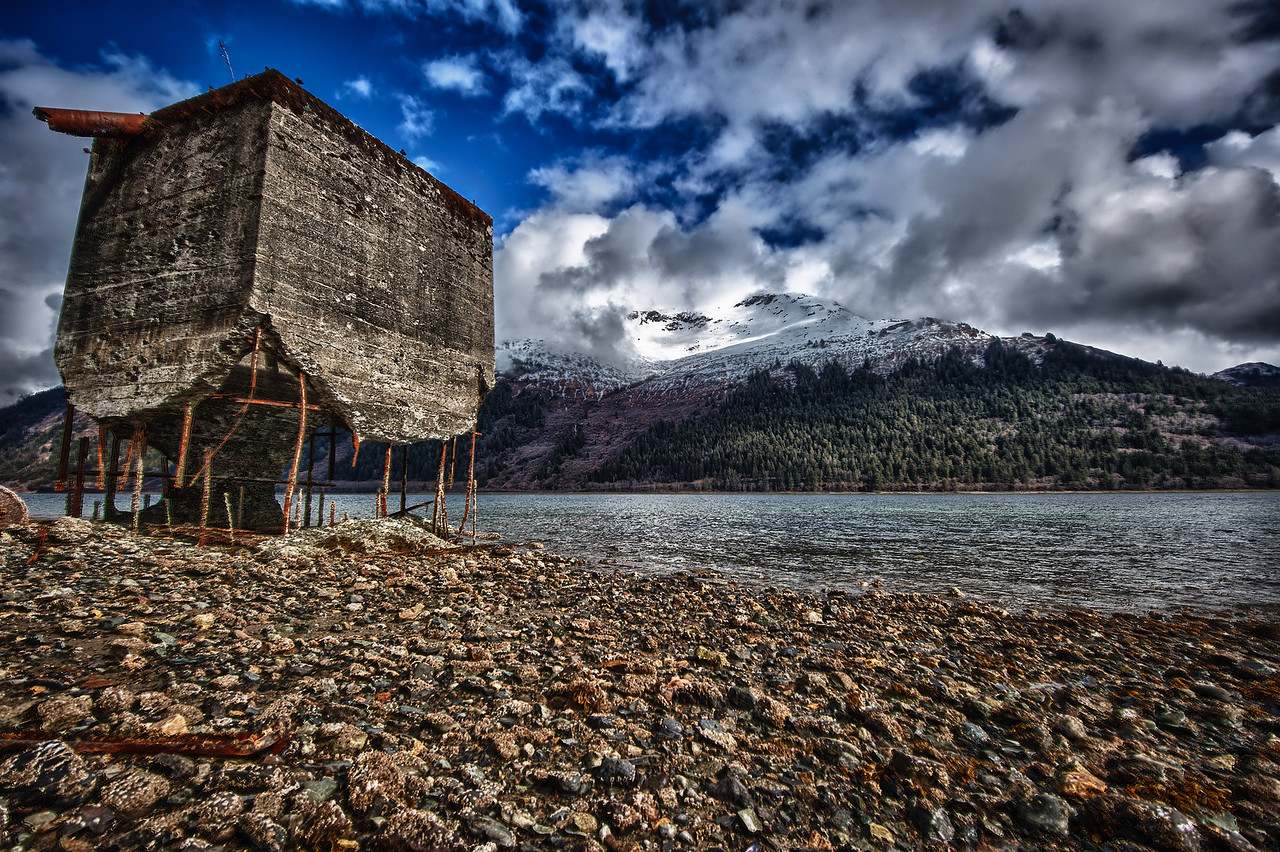 A 7 EV HDR Photograph of remnants of the historic Treadwell Gold Mine on Douglas Alaska, near Juneau Alaska.  The Gastineau Channel is the water that is visible.  Taken with a Nikon d700, edited in HDR Efex Pro & Lightroom.