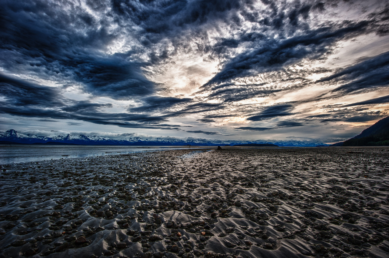 A 9 EV HDR Photograph taken at Eagle Beach, near Juneau Alaska.  Looking here toward the Chillkat Mountains near sunset.  Taken with a Nikon d700, edited in HDR Efex Pro & Lightroom.
