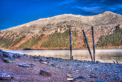 A 9 EV HDR Photograph of Remnants of the Treadwell Gold Mine on Douglas Island Alaska, near Juneau Alaska, looking across the Gastineau Channel at Mt. Roberts.  Shot with a Sony Alpha a300, edited in Photomatix & Lightroom.