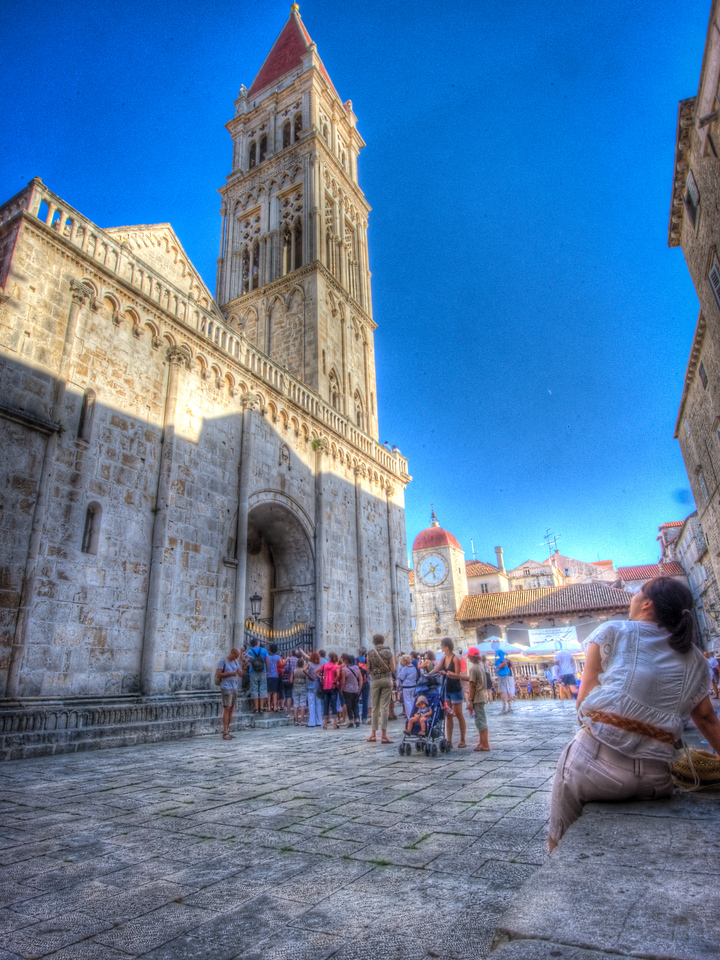A 7 EV HDR Photograph of people admiring a church in Croatia.  Taken with a Nikon d700, edited in Photomatix & Lightroom.