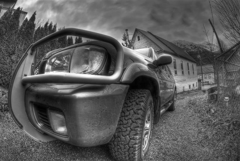 A 9 EV HDR photograph of the front corner of a SUV.  Taken with a Sony Alpha a300, edited in Photomatix & Lightroom.