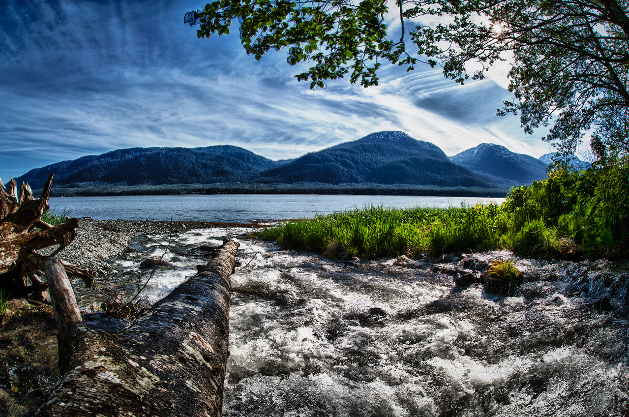 A 5 EV HDR Photograph of a creek flowing from below Mt. Robert's near Juneau Alaska in to the Gastineau Channel.  Visible across the Channel is Douglas Island Alaska.  Taken with a Nikon d700, edited in HDR Efex Pro & Lightroom.