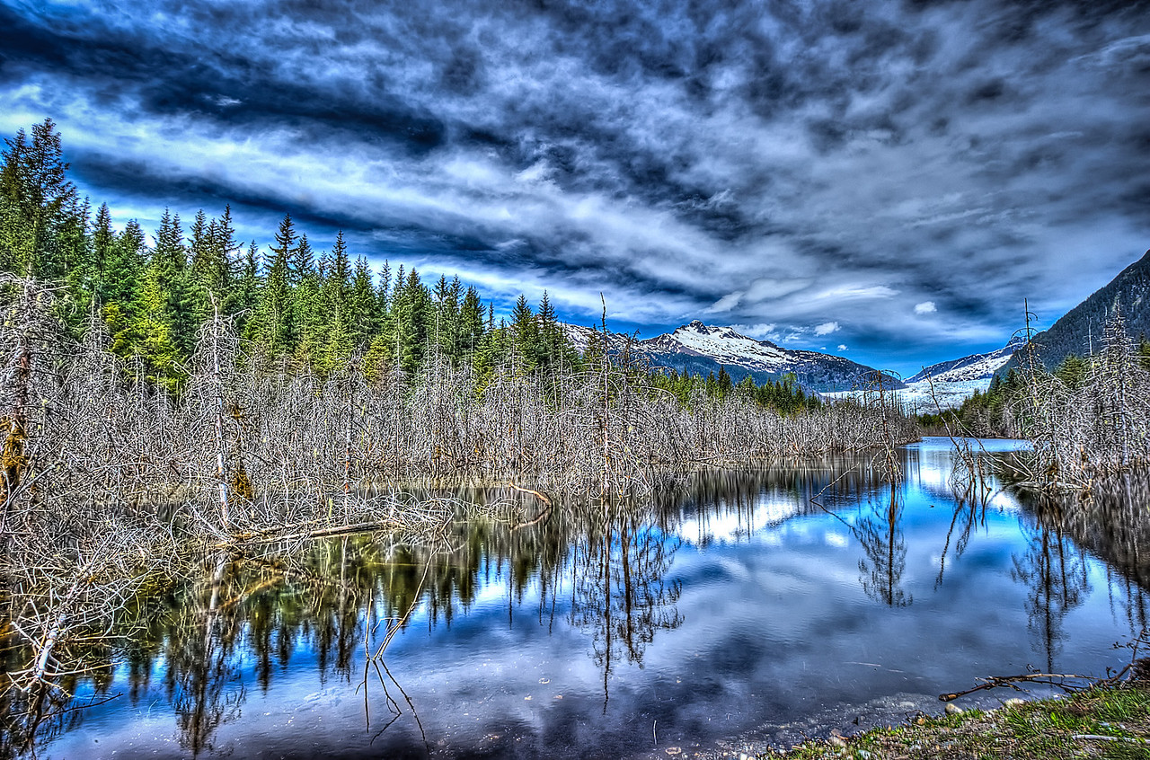 A 5 EV HDR Photograph of the Mendenhall Valley near the Mendenhall Glacier seen in the background in Juneau Alaska.  Taken with a Nikon d700, edited in Photomatix & Lightroom.