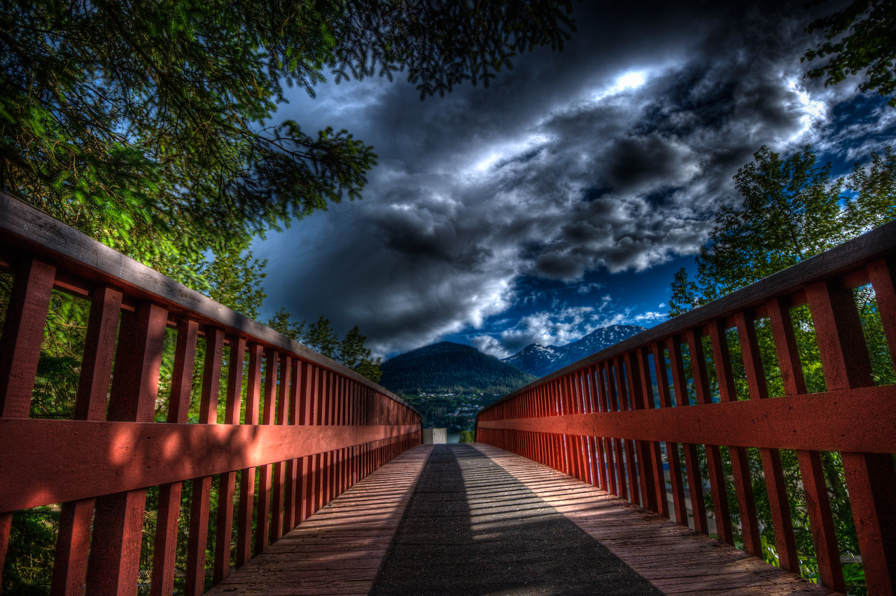 A 7 EV HDR Photograph of a foot bridge in Juneau alaska, the hills in the background are on Douglas Island Alaska.  Taken with a Nikon d700, edited in Photomatix & Lightroom.