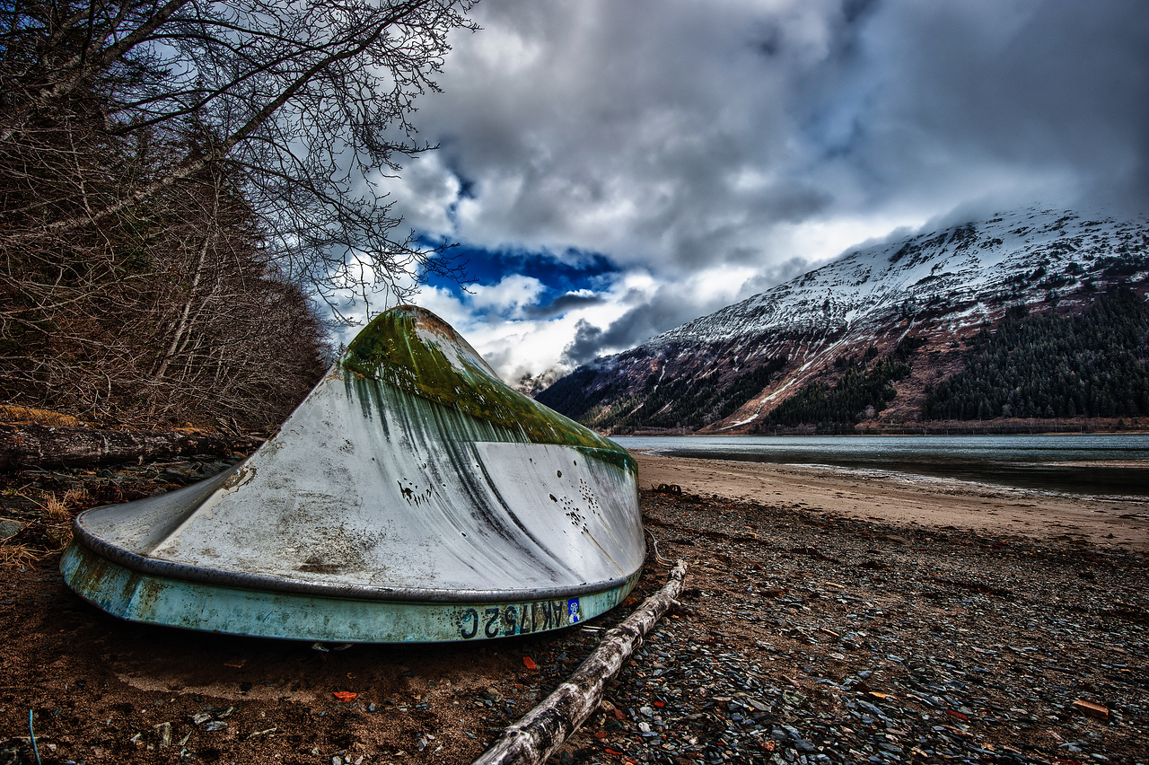 A 7 EV HDR Photograph of an abandoned & overturned boat at Sandy Beach on Douglas Island Alaska across the gastineau Channel from Juneau Alaska.  Taken with a Nikon d700, edited in HDR Efex Pro & Lightroom.