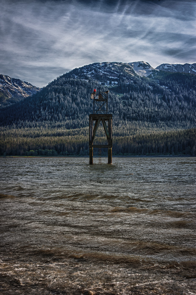 A 5 EV HDR Photograph of a water marker in the Gastineau Channel looking towards Douglas Island Alaska, near Juneau Alaska.  Taken with a Nikon d700, edited in HDR Efex Pro & Lightroom.