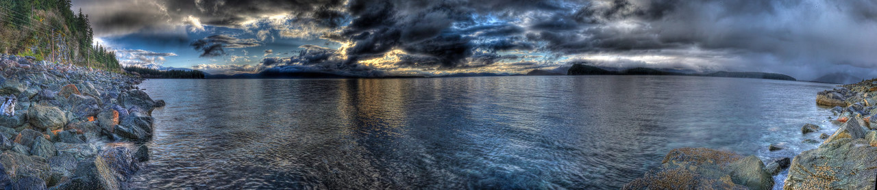 A 7 EV Panoramic HDR Photograph taken on the North Side of Douglas Island Alaska during a late spring sunset in Alaska, my dog Bondo is just visible on the left side of the frame.  Shot with a Nikon d700, edited in Photomatix, PT GUI & Lightroom.