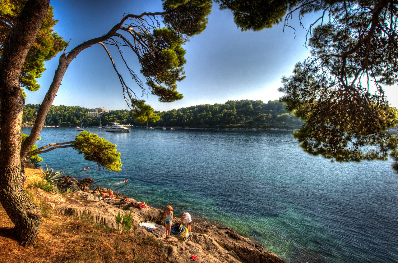 A 7 EV HDR Photograph along the Croatian Coast near the city of Cavtat, swimmers are preparing to enjoy the warm evening sun.  Taken with a Nikon d700, edited in Photomatix & Lightroom.