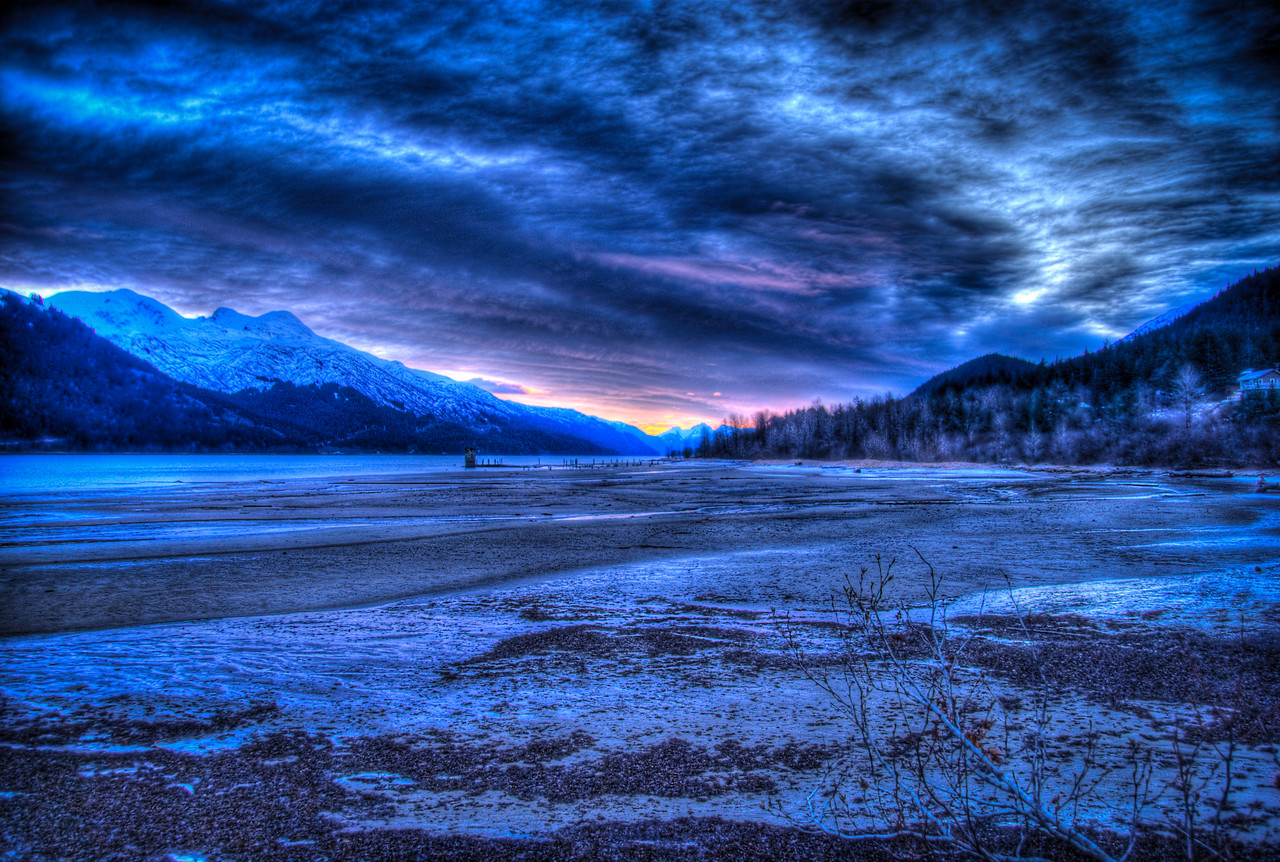 A 9 EV HDR photograph taken at sunrise overlooking Sandy Beach on Douglas Island Alaska, near Juneau Alaska, remnants of the Treadwell Gold Mine are visible in the distance.  Shot with a Sony Alpha a300, edited in Photomatix & Lightroom.