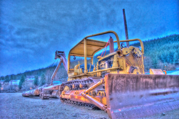 HDR photograph of a Bulldozer on Douglas Island near Juneau Alaska, another of my early HDR photographs, taken with a Sony Alpha a300, edited in Photomatix & Lightroom.