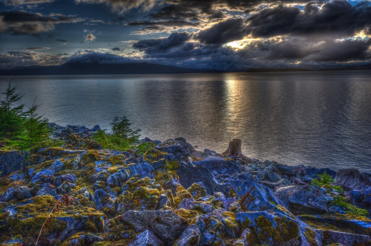 A 7 EV HDR photograph taken during a late spring sunset on the North side of Douglas Island Alaska with phenomenal clouds.  Taken with a Nikon d700, edited in Photomatix & Lightroom.
