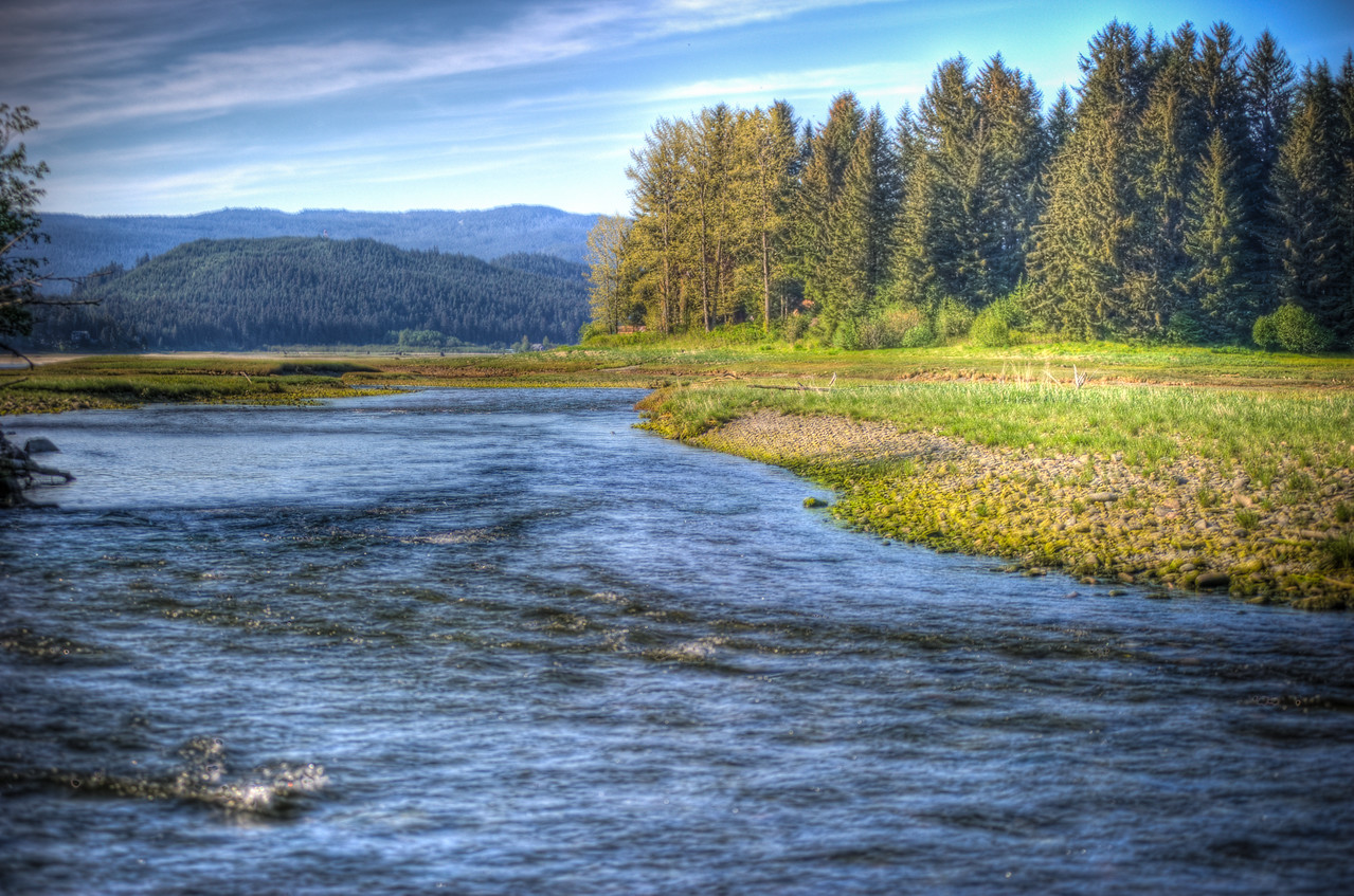 A 5 EV HDR Photograph of Fish Creek as it flows from Douglas Island Alaska toward the Gastineau Channel.  This is a common place for Fly Fishing for Salmon as they 'run' up their spawn.  Taken with a Nikon d700, edited in Photomatix & Lightroom.