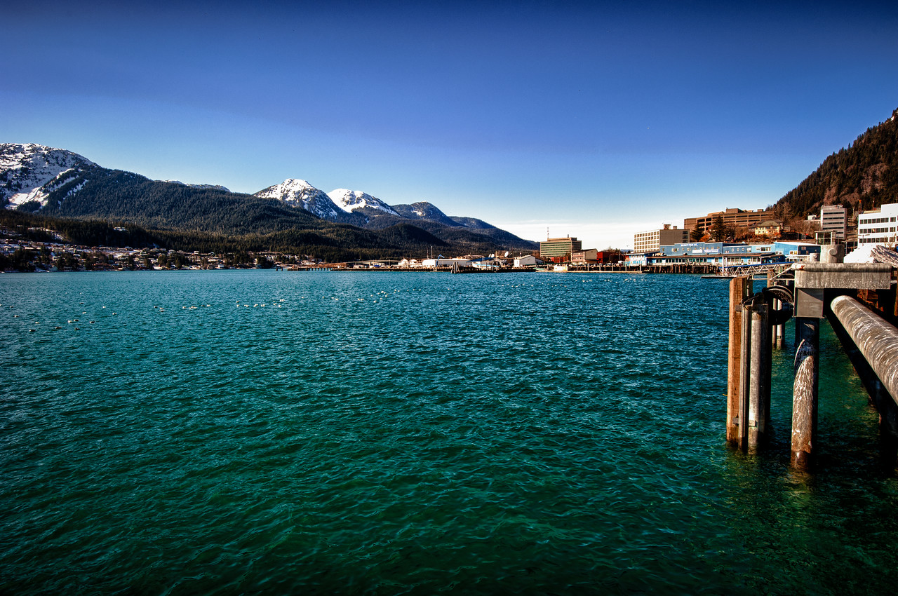A 5 EV HDR Photograph from the cruise ship docks downtown Juneau Alaska looking across the Gastineau Channel at Douglas Island Alaska.  Taken with a Nikon d700, edited in Photomatix & Lightroom.