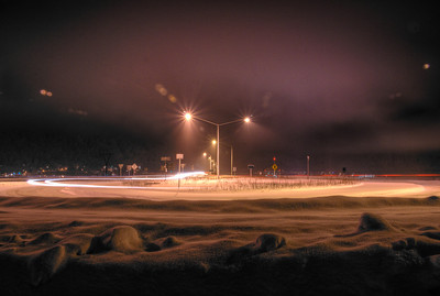 A 3 EV HDR photograph taken of the roundabout on the Douglas Island Side of the Douglas Bridge near Juneau Alaska.  Shot with a Sony Alpha a300, edited in Photomatix & Lightroom.