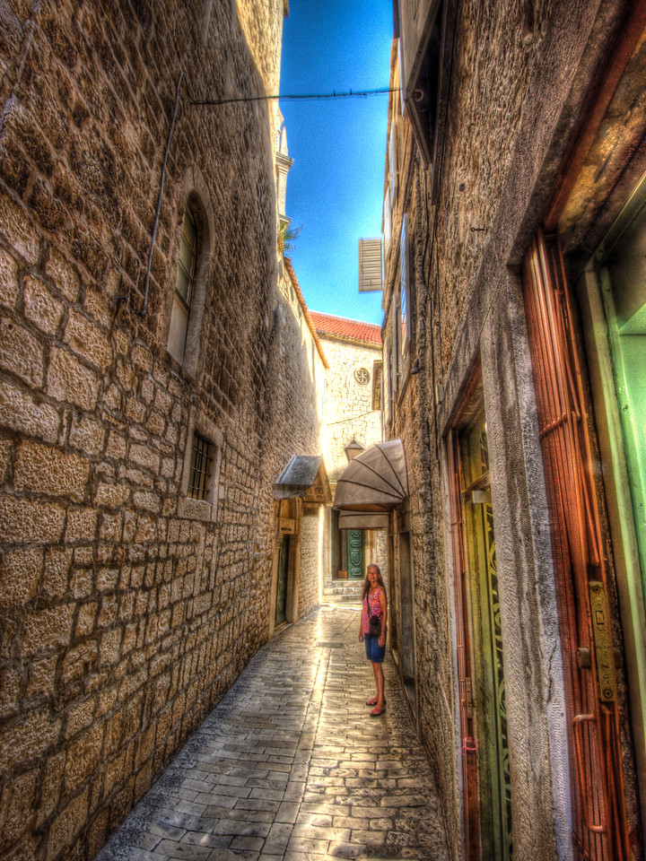 A 7 EV HDR Photograph of narrow cobbled streets and family in Zadar Croatia.  Taken with a Nikon d700, edited in Photomatix & Lightroom.