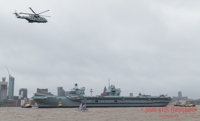Merlin overflies HMS Prince of Wales down the Liverpool waterfront