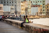 Locals on the seawall in Havana.