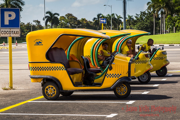Cocotaxi's lined up and waiting for tourists