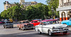 Classical cars pass the Parque Central Hotel