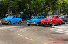 Colourful old timers wait at the lights