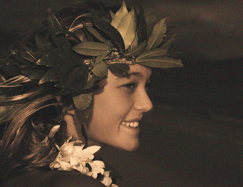 portrait of a young hula dancer wearing a maile haku