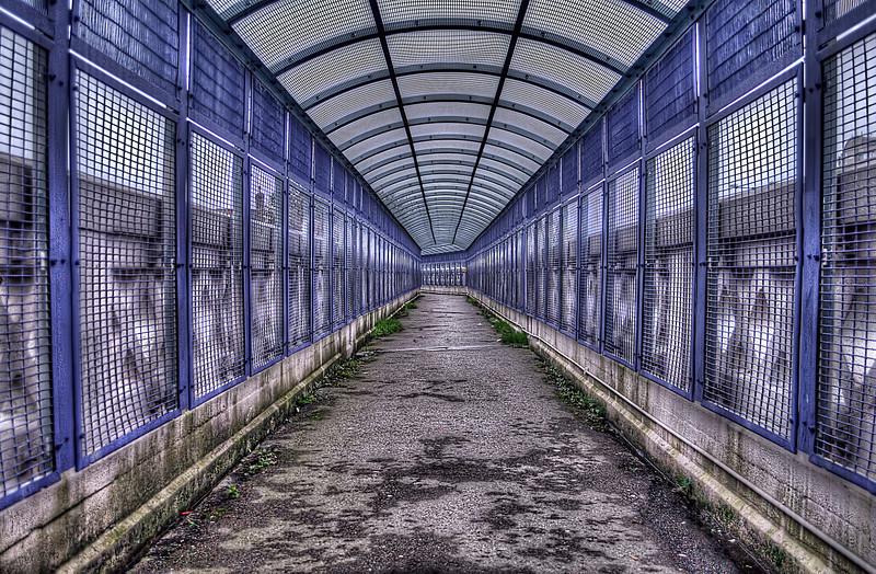Railway Bridge walkway with cage over walkway