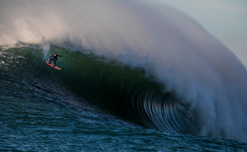 Surfing at Mavericks in Half Moon Bay, California.
