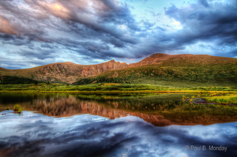 Moose Ripples - This is an HDR photograph of Mount Bierstadt at sunset.  The HDR was necessary to capture the incredible difference in light.  The ripples in the lake are from bathing moose.
