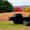 "Tony Smith ""Source"" Storm King Arts Center 2016 New Windsor, NY<br /> The Smith sculpture is positioned to greet visitors close to the Museum Hill entrance to the park. Source is one of the artist's ""presences,"" designed to have a formal correspondence with the landscape, originally made for Documenta IV in Kassel, Germany. The monumental steel work weighs more than 12,000 pounds.  3 editions exist"