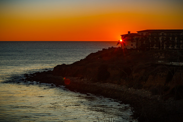 Last touch of sun is visible atop the palm tree at the edge of Terranea Resort