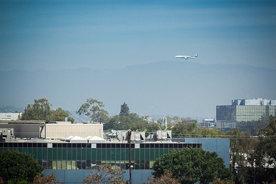 My coworkers and I could watch the shuttle land from Big Red Button's parking garage, but, even from nearby Douglas Station, shots of aircraft on final approach are not that great