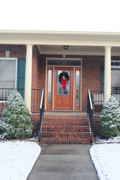 I got up at 6:45am and was putting the wreath on the door just for this shot.  Yeah, I'm nuts.  But I love Xmas decorations with snow.  And we SO rarely get the chance to take the shots.