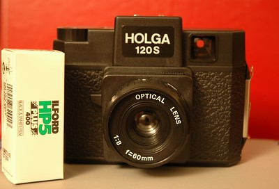 This is the other camera that I've shot with alongside the Nikon.  The Holga is a medium-format camera which uses 120 film.  In stark contrast to the Nikon, this camera offers almost no control...there is an aperture lever with f/8 and f/11 stops and a focus ring, but no through-the-lens focusing.   Therefore, one must estimate distance to the subject, focus using icons on the lens barrel which map roughly to 3 ft., 9 ft, 18 ft., and 30 ft. to infinity.  Then simply press the shutter release lever (1/100 sec.) and advance to the next exposure manually.  Furthermore, the lens is made of plastic, as is almost every other part of the camera.  Some consider this a carnival toy camera, others see it as a tool for producing fine art.  Because of the manual film advancing, it is possible to (accidently or deliberately) double-expose a photo, and it's even possible to produce a panoramic effect.  As a result of the cheap construction and relative lack of quality control, light leaks abound, and no two cameras have the same optical characteristics.  People are known to seal these up with black gaffer tape to seal out light leaks, and others just let them in.  There is a legendary cult status around these cameras.  The pictures are typically vignetted, soft, often out of focus, and show signs of light leakage.  The results are often ethereal and dreamy looking, with the center in some degree of focus and more blurry towards the edges.  In the right hands, this thing can produce fine art.  I haven't used this camera in quite a while, as developing the uncommonly used 120 format film is a lot more expensive than a typical roll of 35mm film.  It was great for a novelty though.  Of course, I didn't make this picture of my Holga with a Holga camera, but this is the exception.