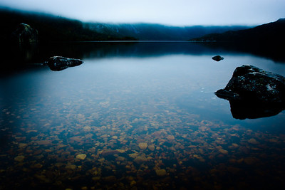 A misty sunrise following an early morning rain at Cradle Mountain's Dove Lake