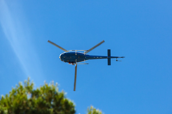 One of the helicopters flies directly overhead