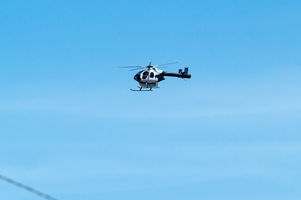 A pair of these Powerline Survey choppers have been circling nearby for the past couple of hours