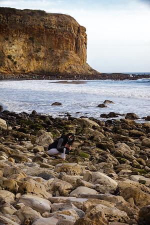 Valerie photographs something on the rocks