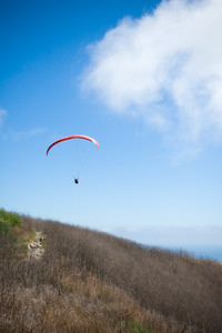 This paraglider appears to be landing, but is actually about to catch an up draft