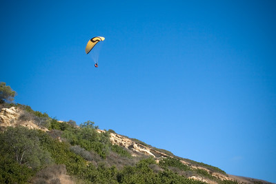 Another paraglider flies overhead (mom, Valerie, and I wonder where they are launching from)
