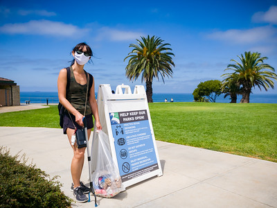 When we return to Point Vicente Interpretive Center, Valerie poses with her final haul.  This sign should also say HELP KEEP OUR PARKS CLEAN!