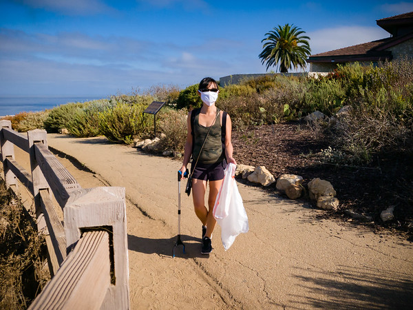 As with my last outing with Valerie, she has brought along her trash collecting gear.  While she hates that people litter, she finds that having an activity to do other than simply walking helps motivate her to get outside.