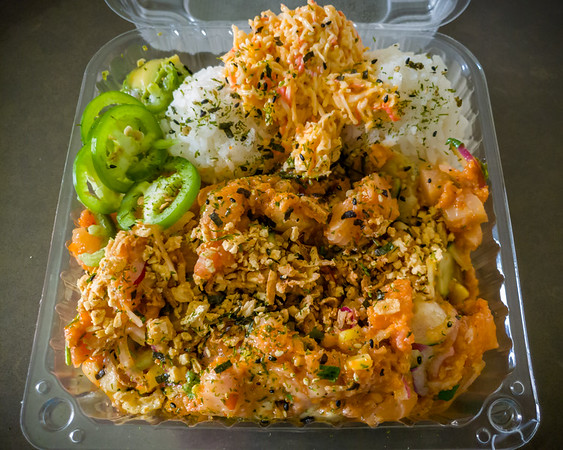 This place is definitely cut from a similar cloth as our go to place King Poke.  Poke Me definitely includes great quality fish (we had spicy tuna, albacore, salmon, and yellowtail) with an abundance of optional ingredients to customize the flavor.  Unlike King Poke, getting a large tilts the balance in favor of the protein (size only increases number of protein scoops from 2 in the small to 6 in the large).  Not sure why we included pineapple as one of our mix-ins...as it is not something we typically associate with poke.  It defintiely threw off the flavor a bit.