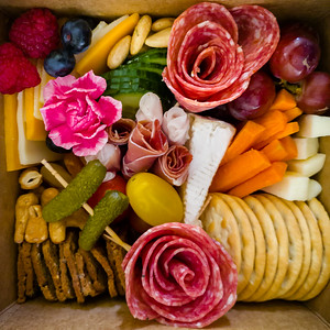 Valerie artfully has put together a charcuterie box for this afternoon's picnic