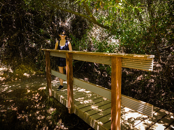 Valerie stands on a bridge over Mariposa Canyon Creek