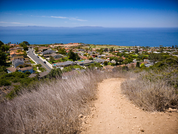 As we continue our climb and Pirate Trail begins to veer north, I look back to check our progress. The corner in view is where Phantom Drive (from the south) meets Pirate Drive.  I'm glad I get this shot of Catalina Island before we lose sight of it.