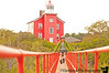 """September 6, 2010 - At the distinctively red Marquette Harbor Lighthouse, we climbed a long red set of stairs and walked down a long narrow red boardwalk type structure to the end of nowhere, and V played around with the rails, until a burly guy pops open a door and asks V, """"Who are you ? Are you with with the Coast Guard ?"""". V says she's just visiting. The chap informs her that she's on federal property that belongs to the United States Coast Guard. Absolutely no public access!!! """"You better get out of here before you are arrested"""", he says!<br /> <br /> So we run down the stairs and drive away as fast as we can. So that's how we manage to make the 6pm cruise in Munising, just in the nick of time. The cruise is about to start when V rushes in waving two large bills, yelling """"4 tickets pls!"""". They place quick phone calls to the ship so it doesn't leave the harbor just yet. An electric golf cart is dispatched from the ship & it rushes through the harbor lanes headed towards us. It stops for barely a sec & we hop in. We are then wisked off to the ship at the other end of the harbor as fast as we can. Pics from the Pictured Rocks cruise on schedule tomorrow! Adios, UP! A  7 hour drive back to Rockford begins..."""