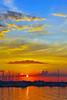 Sunset over the Oswego, New York harbor on Lake Ontario.<br /> <br /> Scott Thomas