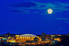 Full moon over the Carrier Dome on the Syracuse Univeristy campus in Syracuse, New York.