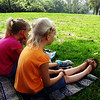 Cute Girls Watching Civil War Reenactment at Central Park in Huntington Beach in CA