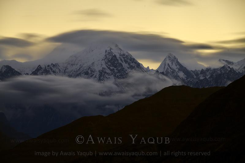 Clouds worship a mountain in Hunza valley of Pakistan in Karakoram range